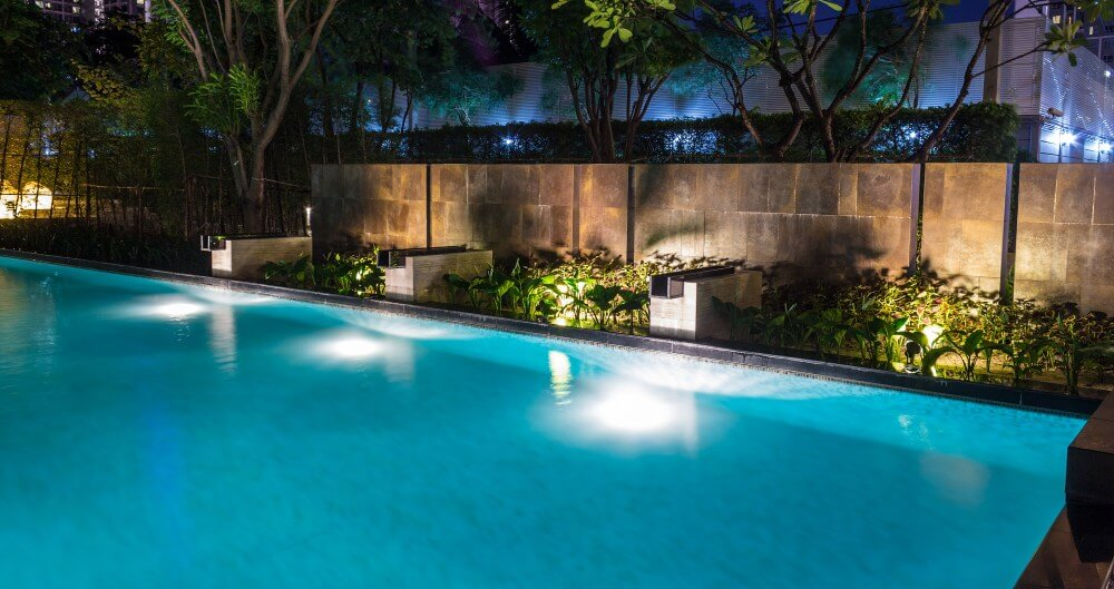 Pool lighting in backyard at night